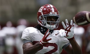 Alabama football running back Najee Harris catches a football at Tuesday practice