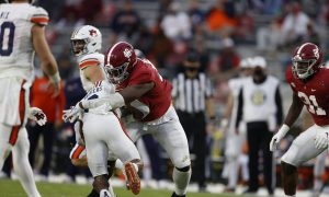 Phidarian Mathis (No. 48) makes a tackle in 2020 Iron Bowl versus Auburn