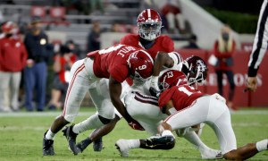 Malachi Moore (No. 13) of Alabama helps with tackling Miss. State RB