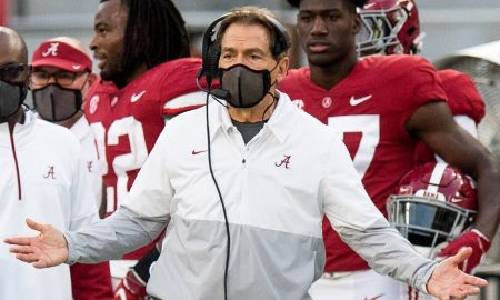 Nick Saban gestures to the official from the sidelines