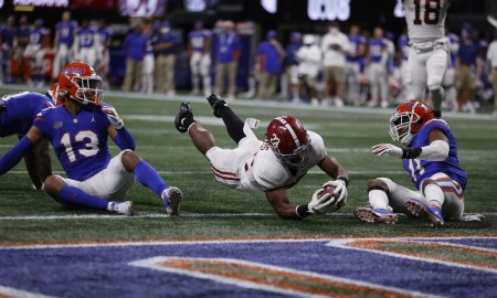 Najee Harris dives for a touchdown in SEC Champiosnhip game