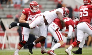 Christian Barmore (No. 58) of Alabama sacks Feleipe Franks of Arkansas