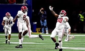 Alabama LB Christian Harris and Phidarian Mathis celebrate SEC Champiosnhip