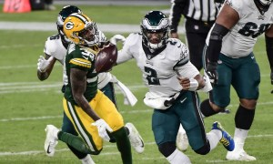 Jalen Hurts running with the ball for Eagles versus Packers