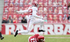 Jaylen Moody (No. 42) of Alabama jumps over Feleipe Franks of Arkansas
