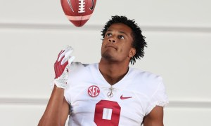 Keanu Koht throws football in the air during Alabama visit