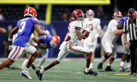 DeVonta Smith moving through Florida's defense with the ball in SEC Championship