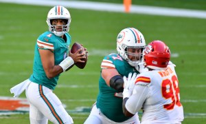 Tua Tagovailoa in the pocket about to throw a pass for Dolphins versus Chiefs
