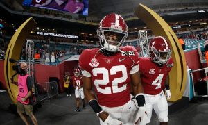 Najee Harris steps on to the field for 2021 CFP National Championship Game between Alabama and Ohio State