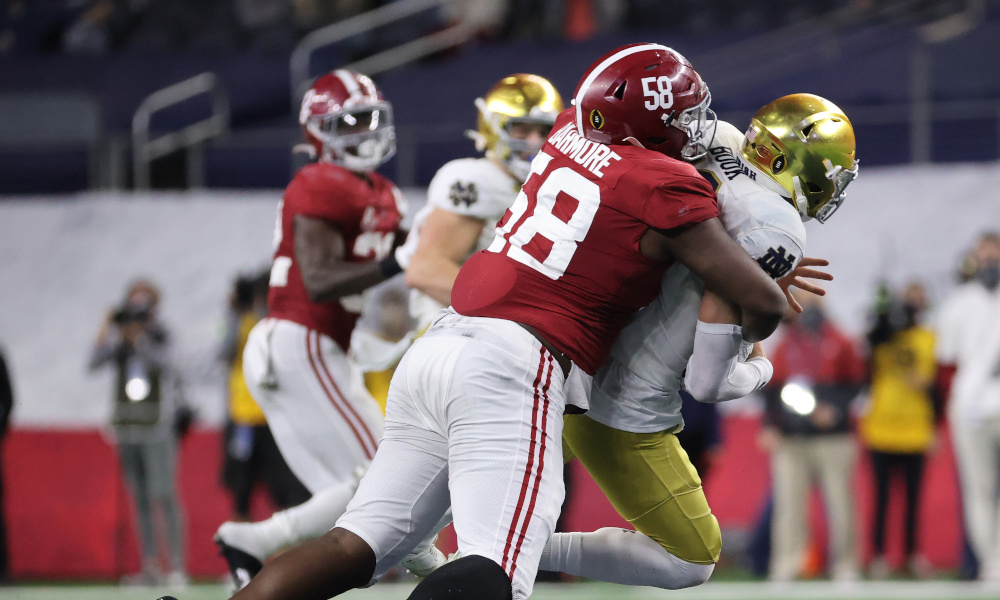 Christian Barmore (No. 58) of Alabama sacks Ian Book at Rose Bowl Game