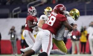 Christian Barmore (No. 58) of Alabama sacks Ian Book at Rose Bowl Game