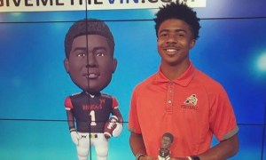 Alabama WR signee JoJO Eare poses with bobble head of himself
