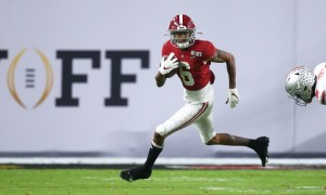DeVonta Smith running with the ball against Ohio State in CFP title game