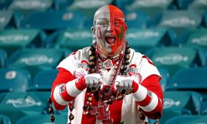 Ohio State fan poses for a photo ahead of the game