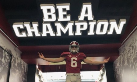 Ty Simpson takes picture in Bryant-Denny Stadium