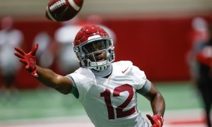 Christian Leary attempts to catch football at Alabama football Spring Prctice