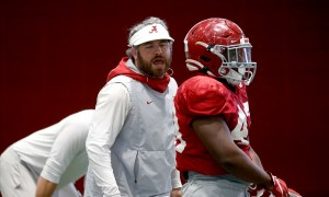 Pete Golding coaching inside linebackers in spring practice