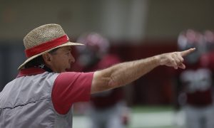 Nick Saban directing players at Alabama spring practice