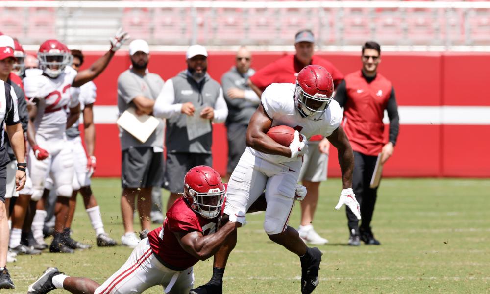 Brian Robinson (No. 4) breaking a tackle at Alabama's spring scrimmage