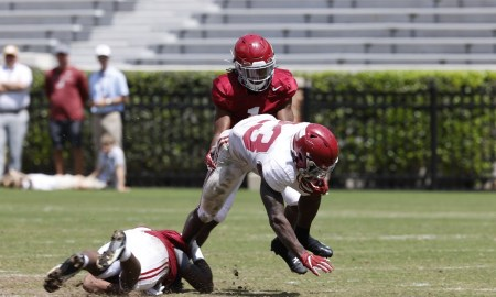 Roydell Williams (No. 23) runs the ball on Ga'Quincy McKinstry (No. 1) at Alabama's second scrimmage