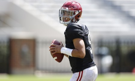 Bryce Young drops back to throw the football