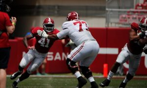 Chris Braswell (No. 41) trying to get around Evan Neal on A-Day