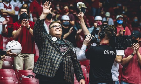Alabama superfan fan Luke Ratliffe waves to the fans on the jumbotron