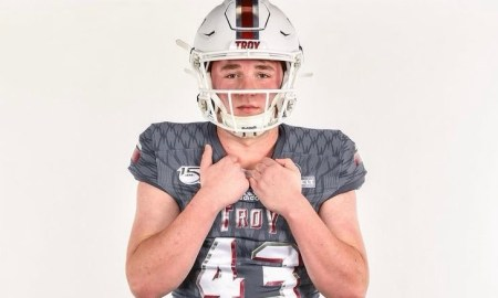 Jack Martin poses for picture in Troy uniform
