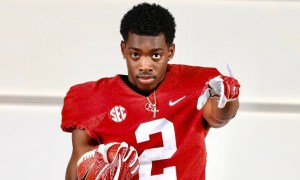 Terrion Arnold posing in his Alabama jersey during a visit