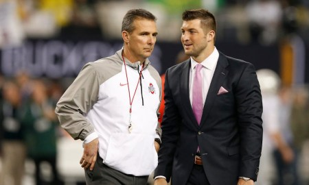 Urban Meyer and Tim Tebow speaking during Ohio State game