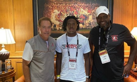 Nathaniel Joseph poses for picture with Nick Saban and Uncle Luke
