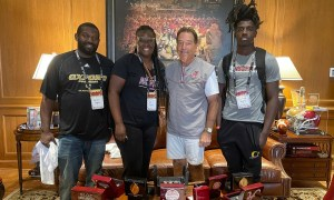 Trequon Fegans stands with mom, dad and Nick Saban during Alabama visit