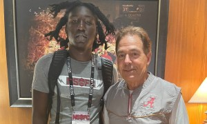 Yhonzae Pierre takes picture with Nick Saban during visit