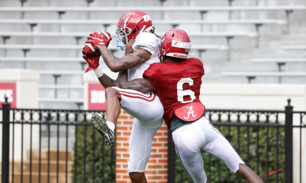 Jameson Williams (No. 1) makes a catch in Alabama practice against Khyree Jackson