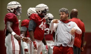 Pete Golding coaching Alabama's defensive players during practice