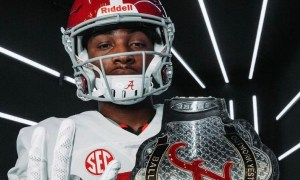 Shazz Preston poses with Alabama turnover belt during visit