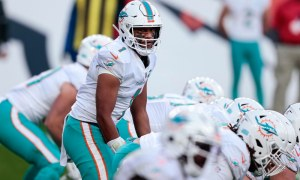 Tua Tagovailoa at line of scrimmage for Dolphins in 2020 game versus Broncos