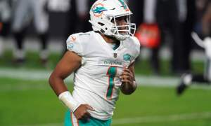 Tua Tagovailoa jogs off the field in 2020 after Dolphins defeat Raiders
