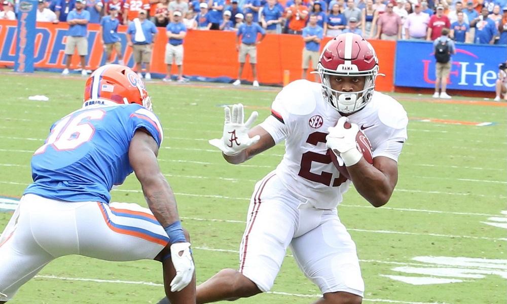 Alabama running back Jase McClellan runs with football against Florida