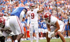 Bryce Young signals an audible to the offense against Florida