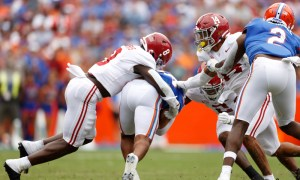 Christian Harris (#8) tackles a running back for Florida