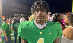 Isaiah Bond poses for picture after game