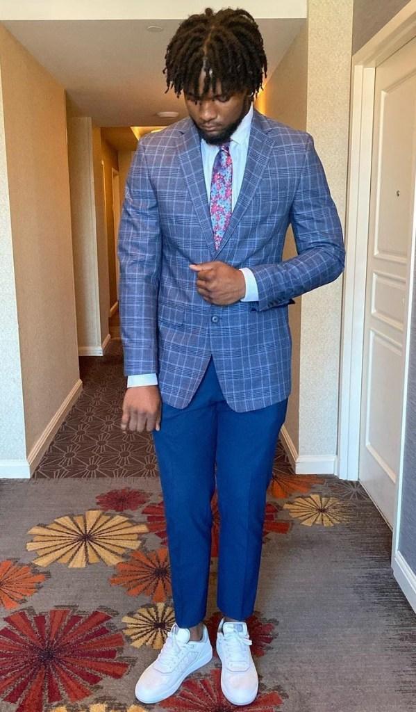 Jahleel Billingsley posing in the hallway in his pregame suit