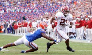 Jase McClellan breaks a tackle against Florida