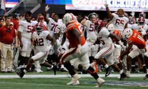 Jaylen Moody (#42) returns an interception for Alabama versus Miami