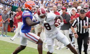 John Metchie gets tackled against Florida