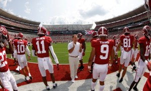Nick Saban and Alabama players coming out of the tunnel for Mercer game
