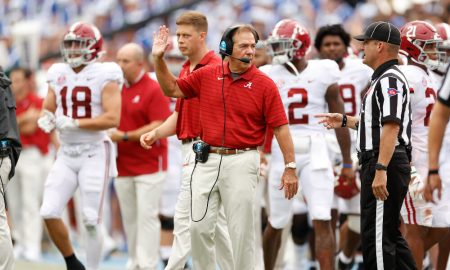 Nick Saban talks to an official on the sidelines