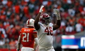 Phidarian Mathis (No. 48) celebrates a big play for Alabama's defense versus Miami