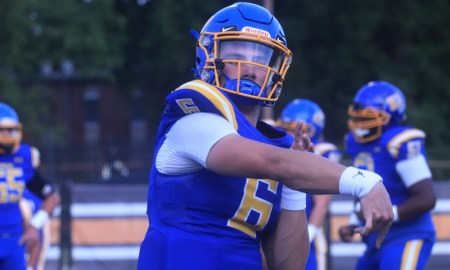Ty Simpson throws the football during warm ups